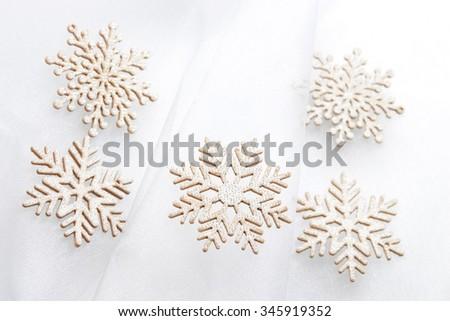 Christmas background: snowflakes on satin fabric - stock photo