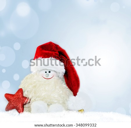 Christmas background. Snowman in santa hat.