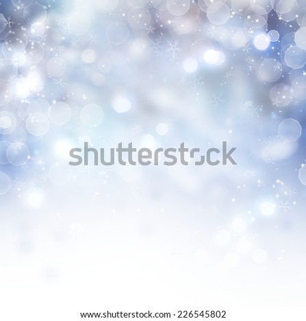 Christmas Background. Winter Holiday Snow Blue Background with snowflakes and stars. Christmas Abstract Defocused Blurred Glowing Backdrop. Elegant Bokeh - stock photo