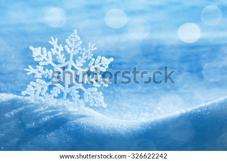 Christmas background with a decorative snowflake on brilliant snow - stock photo