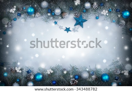 Christmas background with a frame of fir branches decorated - stock photo