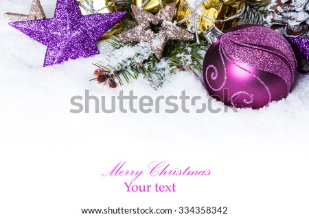 Christmas background with a purple ornament on snow, Holiday decoration  - stock photo