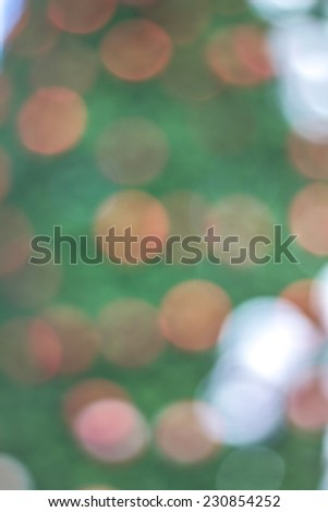 Christmas background with a red ornament, golden gift box, berries and fir in snow - stock photo