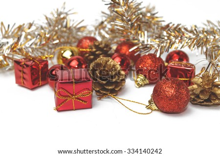 Christmas background with a small red gift box, soft focus.