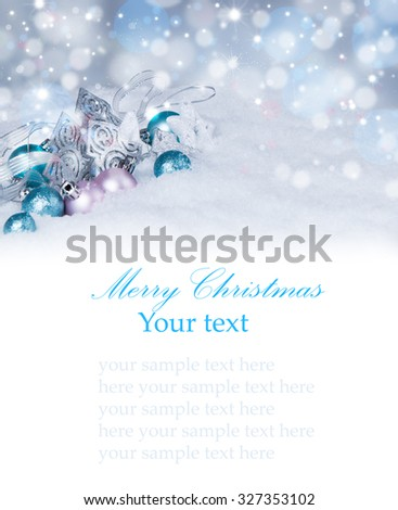 Christmas background with baubles,snow and snowflakes, free space for text. Christmas decoration.