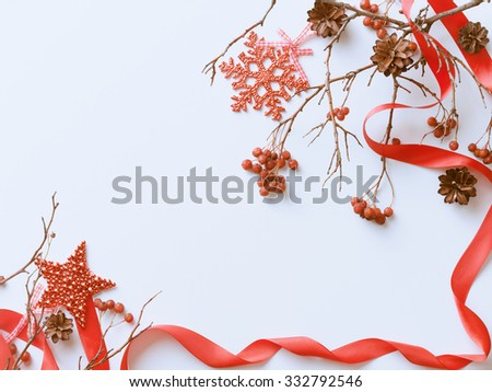 Christmas background with berries, decorations, pine cones and red ribbon - stock photo