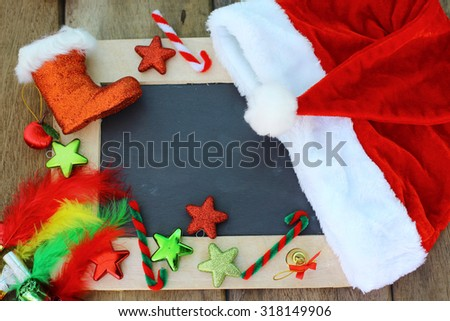 Christmas background with blank chalkboard for copy space and Christmas decorations.  - stock photo