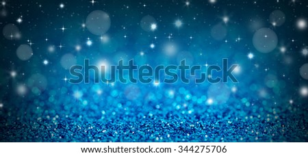 Christmas background with blue glitters, sparkles and bokeh - stock photo