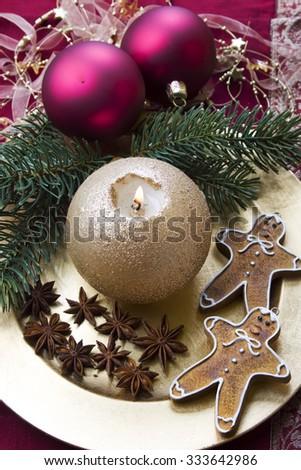 Christmas background with candle, baubles, pine branches and gingerbread cookies.  - stock photo