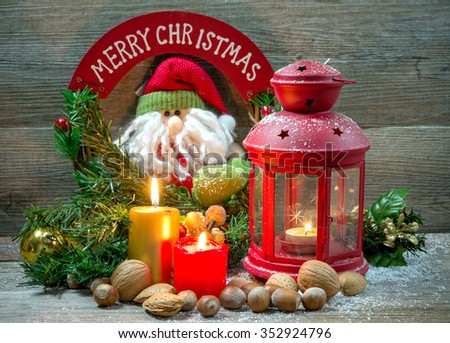 Christmas background with candles, dried fruits on wooden table