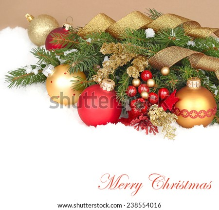 Christmas background with Christmas balls and fir-tree branches.