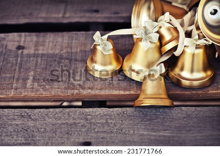 Christmas background with Christmas decoration shine bells with ribbon bows on a wooden table background with copy space, Grunge style, - stock photo