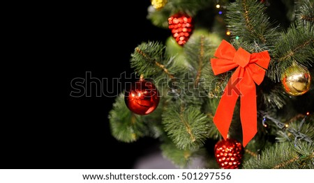 Christmas background with Christmas tree and decorations with space for text.