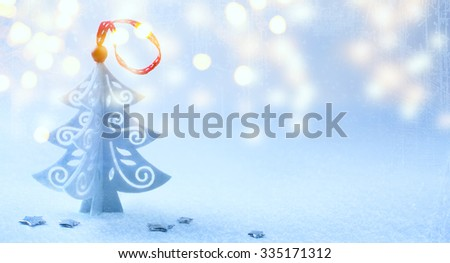 Christmas background with Christmas tree ,snow and snowflakes - stock photo