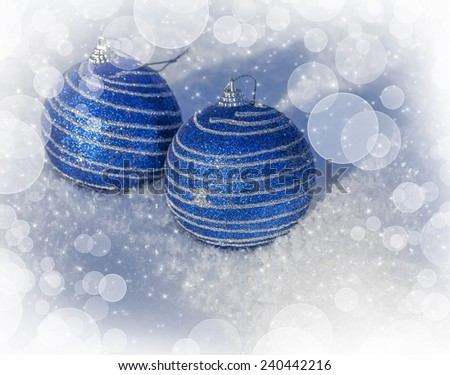 Christmas background with colorful balls in winter on snow - stock photo