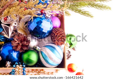 Christmas background with cones, color balls and berries for beautiful Holiday design