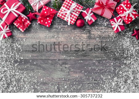 Christmas background with decorations and gift boxes on wooden board - stock photo