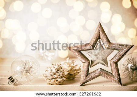 Christmas background with decorative star,Christmas balls and pine cones - stock photo
