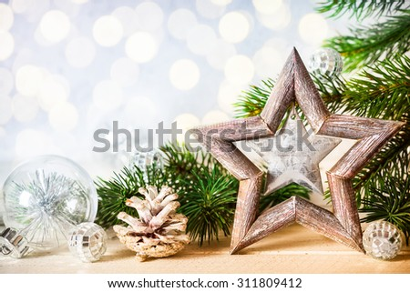 Christmas background with decorative star, fir branches and pine cones - stock photo