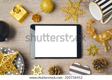 Christmas background with digital tablet and decorations. View from above - stock photo
