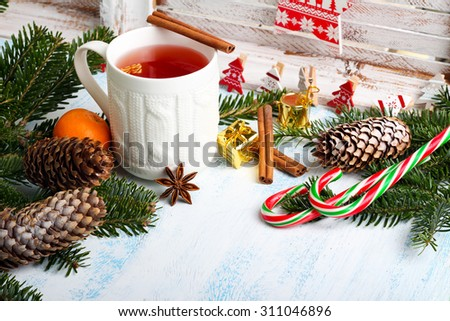 Christmas background with festive decoration over painted surface - stock photo