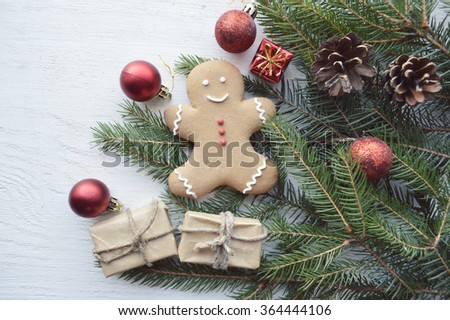 Christmas background with fir branches, pine cones, christmas cookies, cinnamon sticks and anise stars. Top view. Copy space.Christmas cookies - stock photo