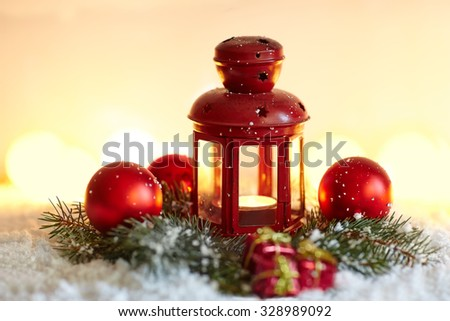 Christmas background with fir tree and lantern in snow - stock photo