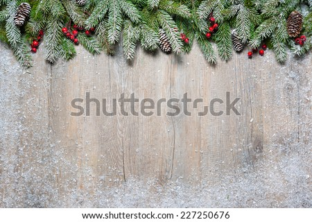 Christmas background with fir tree on old wooden board - stock photo