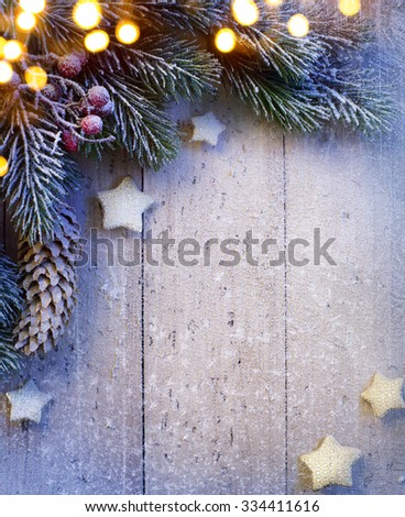 Christmas background with fir twigs and golden stars - stock photo