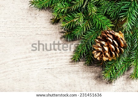 Christmas background with fir twigs. Christmas rustic background - vintage planked wood with pine brunch and free text space