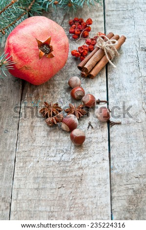 Christmas background with fruits pomegranate, nuts and spices - stock photo