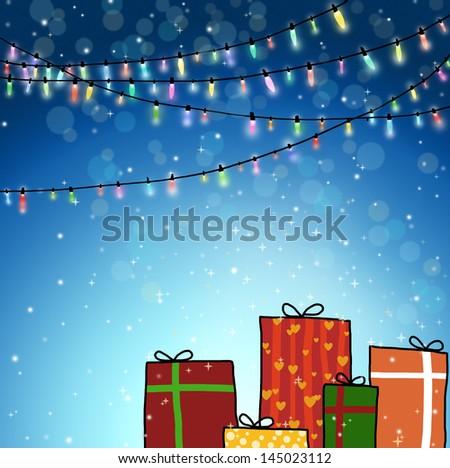 Christmas background with gift and Christmas lights. - stock photo
