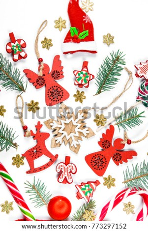 Christmas background with gifts, candy, New Year decorations, toys, branch of Xmas tree on a white background. Concept of advertising, shopping, discounts and gifts for the winter holidays
