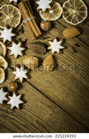 christmas background with ginger-breads, fruits, herbs and spices