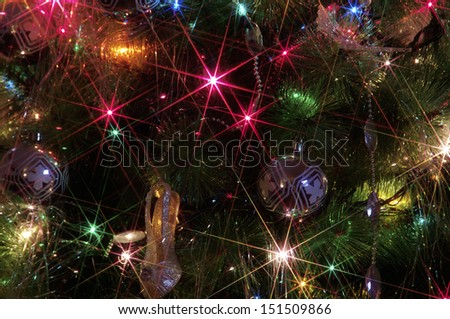 Christmas background with golden ornaments and Christmas lights  - stock photo