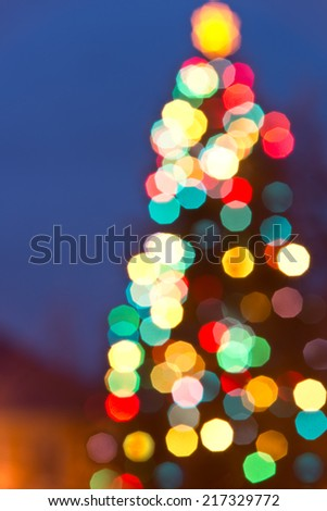 christmas background with multicolored ornament in the night - stock photo