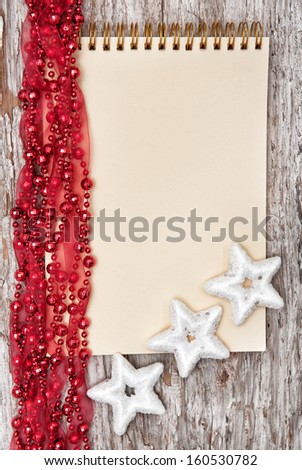 Christmas background with notebook and garland - stock photo