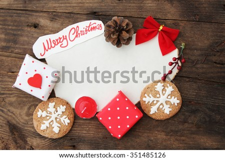 Christmas background with paper, gift box, cookies, pine cone and ribbon - copy space for text