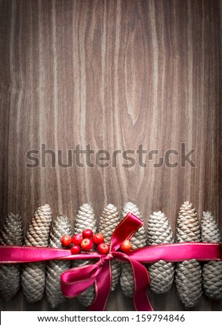 Christmas background with pinecones and a red Christmas ribbon/ Christmas decoration with Pine Cone - stock photo