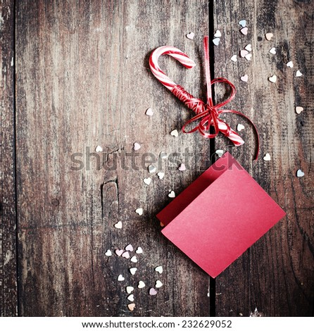 Christmas background with red and white candy canes on textured wooden background - stock photo