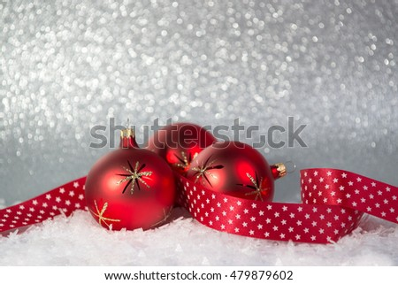 Christmas background with red balls on a snow
