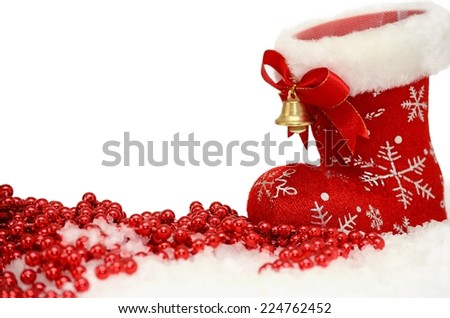 Christmas background with red Santa's boot in snow on white - stock photo