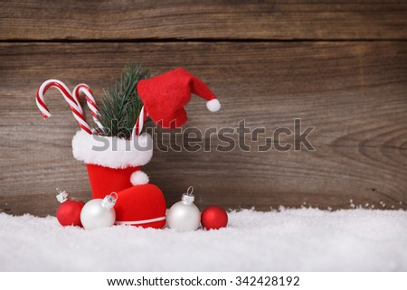 christmas background with santas boot and candy cane  - stock photo