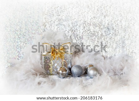 Christmas background with silver balls and present - stock photo