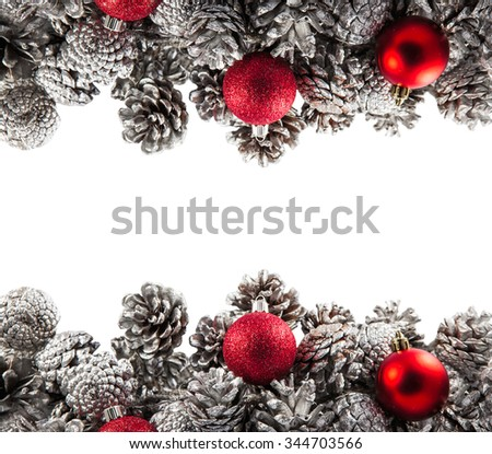 Christmas background with silver pine cones and red glitter shiny balls