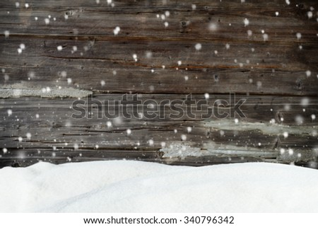 Christmas background with snow and blurred wood texture - stock photo