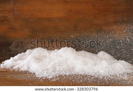 Christmas background with snow over wooden background with glitter overlay - stock photo