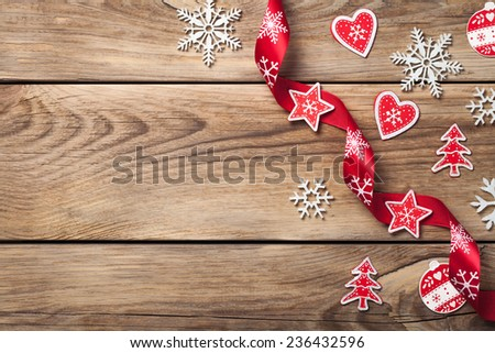 Christmas background with snowflakes and red decoration on wooden table. Copy space. Top view - stock photo