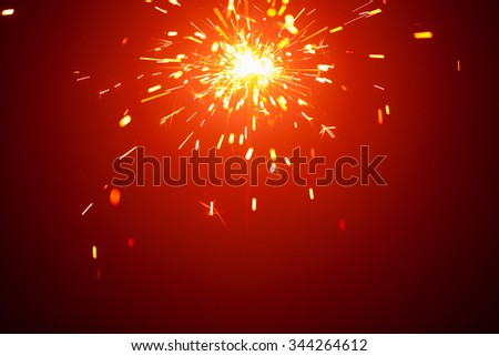 Christmas background with sparkler light and copy-space