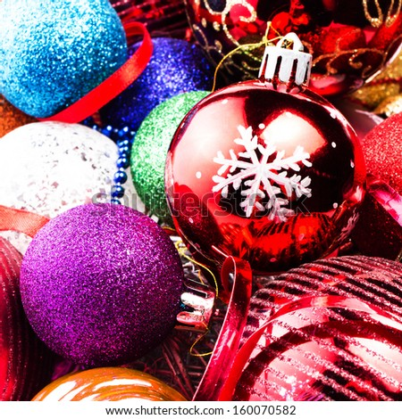 Christmas background with Sparkling twinkling colourful Christmas baubles